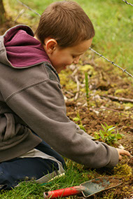 Child gardening at Baxter Barn